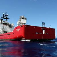 A 'pinger' locator is towed behind the Australian Defence Vessel Ocean Shield in the southern Indian Ocean during the search for the flight data recorder and cockpit voice recorder from the missing Malaysian Airlines jetliner on Saturday. | REUTERS