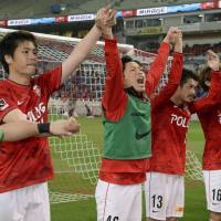 That was close: Urawa players salute their supporters after defeating Tokushima on Wednesday. | KYODO