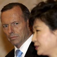 Australian Prime Minister Tony Abbott and South Korean President Park Geun-hye appear at a news conference at the presidential house in Seoul on Tuesday. | REUTERS