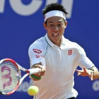 Staying focused: Kei Nishikori returns a ball to Latvia's Ernests Gulbis during the Barcelona Open semifinals on Saturday. | AFP-JIJI
