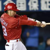 Turn back the clock: Infielder Ryosuke Kikuchi has been one of the driving forces behind the Carp's revival. | KYODO