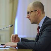 Ukrainian Prime Minister Arseny Yatseniuk chairs a meeting in Kiev on Friday. Yatseniuk accused Russia in a live broadcast the same day of wanting to start World War III by occupying Ukraine 'militarily and politically.' | REUTERS