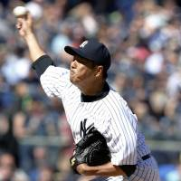 Not his best stuff: Yankees right-hander Hiroki Kuroda, who allowed six hits and four earned runs over 6 1/3 innings, earned a victory over the Red Sox on Saturday. New York beat Boston 7-4. | KYODO