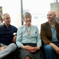 Carrying the legacy of 'The Railway Man': Co-screenwriter Andy Paterson (left) and director Jonathan Teplitzky sit either side of Patricia Lomax, the wife of Eric Lomax, a briton who was forced to work in a Japanese POW camp during World War II. | KAORI SHOJI