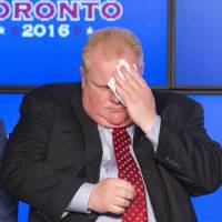 Toronto Mayor Rob Ford wipes his face during an announcement that the Toronto Raptors will host the 2016 NBA All-Star game in Toronto in this file photo taken Sept. 30, 2013. Ford, who gained global notoriety after admitting to smoking crack cocaine, said he is ready to take a break from his re-election campaign and 'get help.'