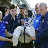 Koichi Wakata is carried out of the Russian Soyuz after the space capsule carrying him and two other astronauts landed Wednesday in the steppes of Kazakhstan.   | KYODO