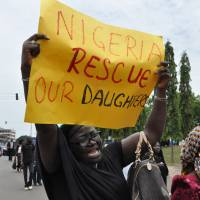 An unidentified mother cries out during an April 29 demonstration with others who have daughters among the kidnapped school girls of government secondary school Chibok, in Abuja, Nigeria.