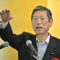 Liberal Democratic Party Vice President Masahiko Komura, a key figure in the ruling bloc's discussions on collective self-defense, gives a speech Wednesday in Tokyo. | KYODO