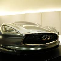 Infiniti chief designer Alfonso Albaisa is interviewed Tuesday at the Nissan Technical Center in Atsugi, Kanagawa Prefecture, behind a quarter-sized model of the Emerg E car. | REUTERS