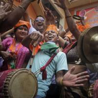Bharatiya Janata Party supporters celebrate in Gauhati, India, on Friday as early election results indicated a landslide victory. | AP