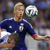 Keisuke Honda fights for the ball during a friendly soccer match against Cyprus in Saitama on Tuesday. | AP