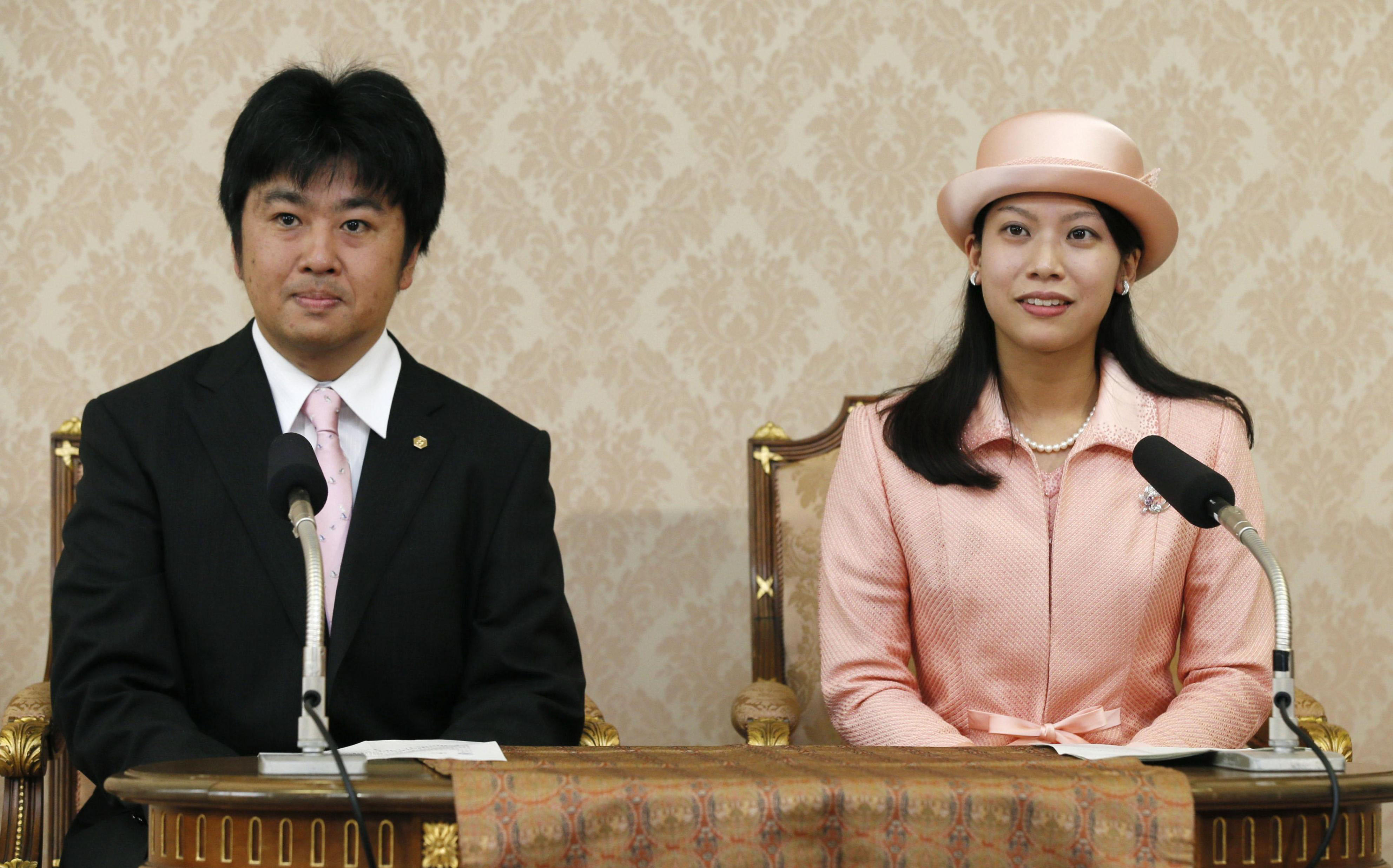 Princess Noriko, 25, and Kunimaro Senge, 40, speak to the media during a news conference at the Imperial Palace in Tokyo on Tuesday, after publicly announcing their engagement. | KYODO