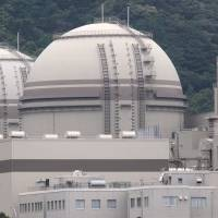 Reactors 4 and 3 stand idle at Kansai Electric Power Co.'s Oi nuclear plant in Fukui Prefecture in June 2012, a month before they became the first units in the country to be restarted after the Fukushima crisis. | BLOOMBERG