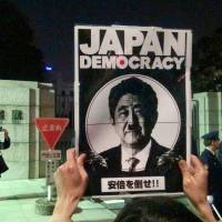 Demonstrators rally in front of the Diet on April 8 to protest Prime Minister Shinzo Abe's plan to reinterpret the Constitution so Japan can legally engage in collective self-defense. | SANG WOO KIM