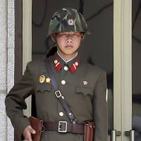 A North Korean soldier stands guard May 14 at the truce village of Panmunjom in the demilitarized zone that separates the two Koreas. | REUTERS