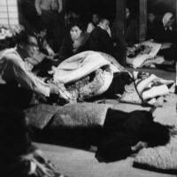A photo taken on March 28, 1961, shows people who fell ill after drinking poisoned wine at a local community meeting in Nabari, Mie Prefecture. | ISE SHIMBUN/KYODO