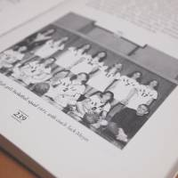 Dark history: One of the remaining copies of 'The American School in Japan: A History of Our First Century' shows teacher Jack Moyer with the girls' basketball team he coached in 1971. Copies of the book were destroyed after Janet Simmons, a former ASIJ student who was abused by Moyer in the early 1970s, confronted staff about the book, which praises Moyer. | JON MITCHELL