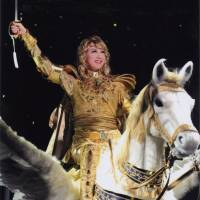 High point: Star of the show Kaname Oki sings 'My Name Is Oscar' as she sits heroically astride her flying horse in 'The Rose of Versailles — Oscar.' | ©TAKARAZUKA REVUE COMPANY