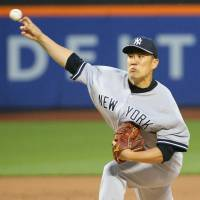 Stellar shutout: Yankees hurler Masahiro Tanaka fires a pitch against the Mets in the first inning on Wednesday night. | REUTERS