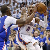 Zero tolerance: Oklahoma City's Russell Westbrook looks to shoot as Los Angeles' Chris Paul defends on Wednesday. | AP