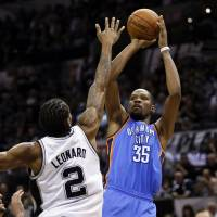 Blown out: Oklahoma City's Kevin Durant puts up a jumper over San Antonio's Kawhi Leonard in Game 2 on Wednesday night. The Spurs pounded the Thunder 112-77. | REUTERS