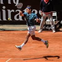 Out early: Roger Federer plays a shot from France's Jeremy Chardy in their second-round match at the Rome Masters on Wednesday. Chardy won 1-6, 6-3, 7-6 (8-6). | AFP-JIJI