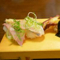 Sea bites: Aji (mackerel) sushi and octopus tentacles at Nanaezushi.  | J.J. O'DONOGHUE