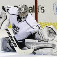 Comeback complete: Los Angeles goalie Jonathan Quick stops a shot against San Jose in Game 7 on Wednesday night. | AP