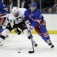 Shoulder to shoulder: Pittsburgh's James Neal (left) battles for the puck with New York's Ryan McDonagh on Wednesday. | AP