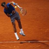 Guided missile: Rafael Nadal serves during his 6-1, 6-0 win over Juan Monaco on Wednesday.   REUTERS