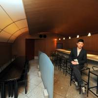 Takeout: Aric Chen, curator for design and architecture at M+ in Hong Kong, sits inside the Kiyotomo sushi bar designed by Shiro Kuramata. The former restaurant will be dismantled and rebuilt as an exhibit at the Hong Kong museum. | YOSHIAKI MIURA