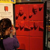 A Lego-like relief lets visitors make molds of their faces together, just remember to shut your eyes and close your mouth before doing it. | JASON JENKINS