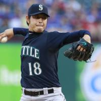 Flame on: Seattle starting pitcher Hisashi Iwakuma delivers during the Mariners' 6-2 win over the Rangers on Tuesday. | AP
