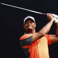 Feeling better: Tiger Woods says recent surgery for a pinched nerve has helped relieve pain in his back. | AFP-JIJI