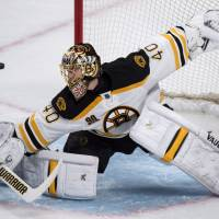 Batted away: Boston's Tuukka Rask deflects a shot against Montreal in Game 4 on Thursday night. The Bruins edged the Canadiens 1-0 in overtime to even the series 2-2. | AP