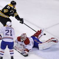Faked out: Boston's Loui Eriksson scores around Montreal's Carey Price in the third period of Game 5 on Saturday night. | AP