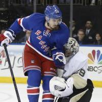 Coming through: Rangers winger Chris Krieder (left) collides with Penguins goalie Marc-Andre Fleury on Sunday. | AP