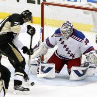 Ironman: New York goalie Henrik Lundqvist saves a shot by Pittsburgh's Evgeni Malkin during the Rangers' 2-1 win in Game 7 of their Eastern Conference semifinal series on Tuesday. | USA TODAY/REUTERS
