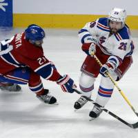 Inspirational: New York's Martin St. Louis (right) is checked by Montreal's Brian Gionta in Game 2 on Monday night. | REUTERS