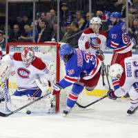 Blocked: New York's Mats Zuccarello shoots between Montreal's Dustin Tokarski (left) and Josh Gorges in Game 3 Thursday. | REUTERS