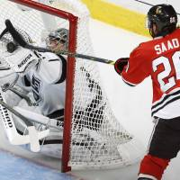 Borderline: Los Angeles' Jonathan Quick makes a save against Chicago's Brandon Saad in Game 5 on Wednesday night.   AP