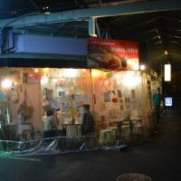 Hole in the wall: Tenma faces the street, enclosed only in clear vinyl.   J.J. O'DONOGHUE