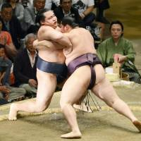 Out you go: Endo pushes yokozuna Kakuryu to the edge of the ring during their bout on Wednesday. | KYODO