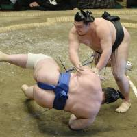 And another one bites the bust: Ikioi sends Aoiyama tumbling to the raised ring on Friday at the Summer Grand Sumo Tournament. | KYODO