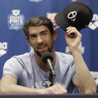 Fire still burns: Michael Phelps answers questions at a news conference on Thursday ahead of this weekend's Grand Prix meet in Charlotte, North Carolina. | AP