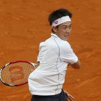 Strong play continues: Kei Nishikori returns a shot from Spain's Guillermo Garcia-Lopez in their second-round match at the Madrid Open on Tuesday. Nishikori won 6-3, 6-1. | AP