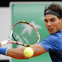 Rallies to win: Rafael Nadal plays a shot from Mikhail Youzhny in their third-round match at the Rome Masters on Thursday. | REUTERS