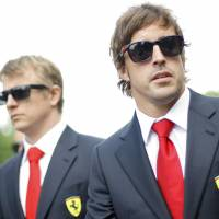 Solemn occasion: F1 drivers Fernando Alonso (right) of Spain and Kimi Raikkonen of Finland arrive Thursday for a memorial service for Ayrton Senna at Imola Racetrack in northern Italy. | REUTERS