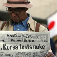 A pedestrian in Tokyo reads a special edition announcing North Korea's nuclear test in October 2006. Any nuclear test by Japan in future would likely cause a domestic and international uproar of a similar scale.   BLOOMBERG