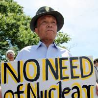 Hard sell: A protester attends an anti-nuclear rally in Tokyo in July 2012. | BLOOMBERG